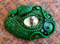Not sure what this is, maybe a pin or paperweight made out of polymer clay, but we like it! #eyeimagery