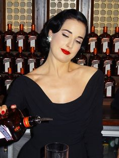 Earlier tonight I was lucky enough to attend, with Rebecca Varidel, the Alternative Media Group Bar Fly, a Cointreau event. It offered up an intimate audience with their ambassador, none other than fetish icon, Dita Von Teese!
