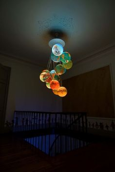 """Beautiful """"chandelier"""" made of 15 world globes. This 2m high piece of art was made by Benoit Vieubled and called """"Monde à l'endroit, Monde à l'envers""""."""
