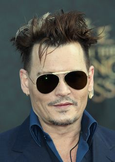"""Johnny Depp Photos - Actor Johnny Depp attends the premiere of Disney's """"Alice Through The Looking Glass at the El Capitan Theatre on May 23, 2016 in Hollywood, California. - Premiere of Disney's 'Alice Through The Looking Glass' - Arrivals"""