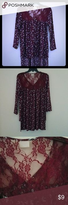 Ditsy floral, lace contrast high low top. Ditsy floral, long sleeve w/ lace contrast high low top. Tops Blouses