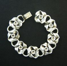 Bracelet | Hector Aguilar. 'Knot'.  Sterling silver. c. 1940s. Taxco / Mexican