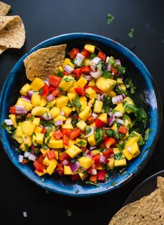 Fresh mango salsa recipe, perfect for tacos, potlucks and more! cookieandkate.com