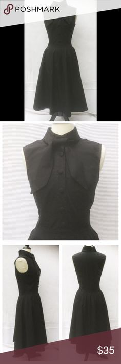 """New aeshakti Fit & Flare Shirt Dress M 8 New Eshakti black fit & flare midi shirt dress. M 8 Measured flat: Underarm to underarm: 34"""" Waist: 28 ¼´ Length: shoulder to waist: 16 ½"""" shoulder to hem: 46"""" Eshakti size chart for 8 bust: 36"""" Square neck, v back, banded waist, hidden side zipper, pleated flared ,midi skirt. Cotton, woven poplin, pre-shrunk, bio-polished, no stretch. Machine wash. New w/ cut out Eshakti tag to prevent returning to Eshakti eshakti Dresses Midi"""