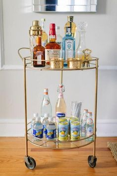 Gold Bar Cart - Contemporary - dining room - Benjamin Moore Cornforth White - The Every Girl