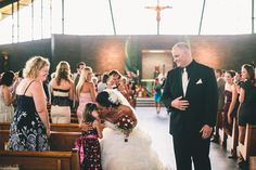 this bride was walking up the aisle with her new husband following their wedding ceremony and stopped to hug one of her students