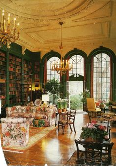 green painted shelves.  With all the greenery and the sofa print it's almost like being outside