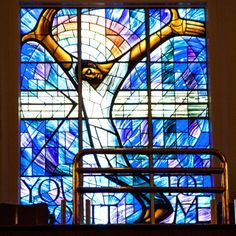 """16th Street Baptist Church Stained glass window donated by the people of Wales after the 1963 bombing of the church. The south-facing window was designed by Welsh artistJohn Petts and depicts a black Christ with his arms outstretched. The right hand symbolizes oppression, his left is asking for forgiveness. The words """"You do it to me"""" refer to Christ's parable of the sheep and the goats."""