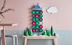 IKEA IDEAS An advent calendar display with paper trees on a table and a castle hanging on a wall Advent Calendars For Kids, Kids Calendar, Diy Advent Calendar, Calendar Ideas, Paper Decorations, Christmas Decorations, Ikea Portugal, Seasonal Decor, Holiday Decor