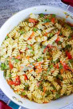 Easy One-Pot Pasta Primavera - A quick and easy vegetarian dinner recipe that only requires one pot.  It's packed with tons of fresh veggies making it a healthy option too!
