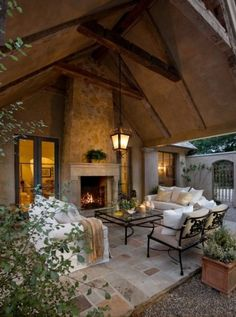 Outdoor fireplace on patio.  Couches & outdoor seating area.  Throw blankets & extra pillows to stay comfy & cozy.  Outdoor living room in Montecito, CA.