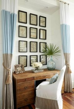 Gorgeous tri-colored curtains and shell shadow boxes