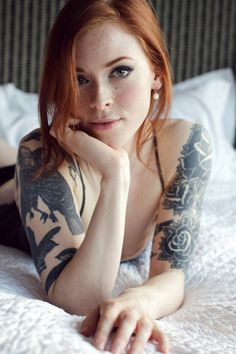 she's a suicide girl. idk her name or whatever. i have just seen her face pop up on tumblr with the little logo in the corner.