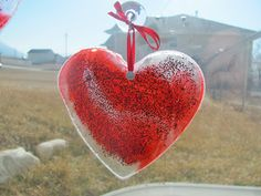 Stain Glass Hearts » made with clear Elmer's glue, glitter and food coloring