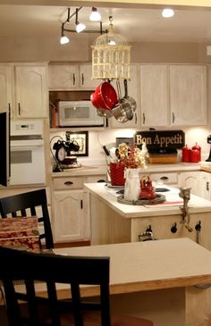 like color scheme for kitchen as red, black white but like black appliances, white cabinets, and red wall (only under cabinets)