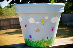 painted flower pot w/finger print decorations - cute way to dress up a potted plant!