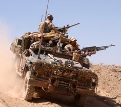 An Australian Surveillance Reconnaissance Vehicle (SRV) patrols outside the perimeter of a forward operating base in Afghanistan.