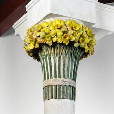 One of the eight capitals comprised of concrete and cast Tiffany glass that make up the Daffodil Terrace. These sit upon marble columns and were salvaged from the remains of Louis Comfort Tiffany's Laurelton Hall estate.