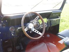 My good old Jeep CJ7 (1981) with Walnut steering wheel.