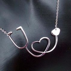 Newest style of our gorgeous medical stethoscope necklace is here! Nurses, doctors, and anyone in--or about to be in—the medical field will love this unique pendant. The stethoscope forms a big heart Medical Assistant, Medical Students, Nurse Gifts, Gamer Gifts, Collar Necklace, Jewelry Gifts, Nurse Jewelry, Jewelry Tree, Jewelry Ideas