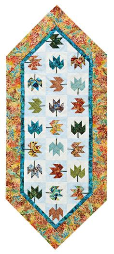 Very cute Fall theme table topper with free pattern from All People Quilt.  Design is by Darlene Zimmerman, called Criss Cross Table Topper.  And, it uses yummy Hoffman batiks.  Who wants to make this ?