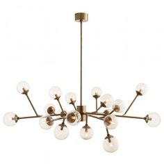 The Dallas Chandelier, one of Arteriors most popular designs, is now available in a vintage brass finish. This 18-light mid-century inspired design features seedy glass spheres and 12 out of 18 arms are adjustable. Approved for use in covered outdoor areas.