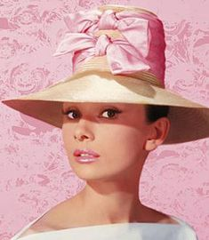 Audrey Hepburn in such a cute hat - pink bows!