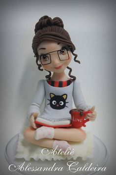 Fondant figure for book lover cake