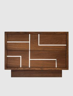 """Lutetia"" is a collection of handmade nightstand and chest in smoked oak or Brazilian walnut with a geometric pattern available in stainless steel or oxidized bronze."