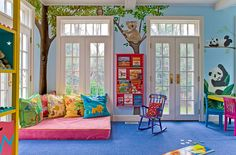 Designer: Nashawtuc Architects, Boston A kid's playroom with a jungle theme is brought to life with this nature scene wall mural. The koala, raccoon, and owl perch themselves on the green trees while the lion and tiger stand by below, making this an exciting and whimsical place for any child.