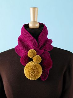 This delightful keyhole scarf with pom-poms is fun and eye-catching. (Lion Brand Yarn)