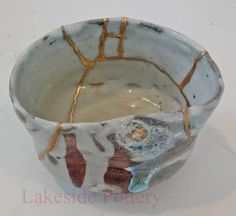 kintsugi restored wood fired tea bowl
