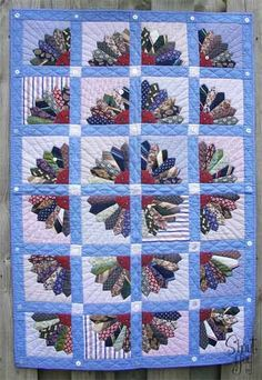 Am I Shouting Yet?: Bloggers Quilt Festival  love this quilt that uses bits of mens shirts and neckties to create each square.