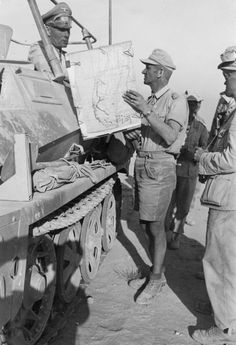 Colonel-General Erwin Rommel discussing a plan of fighting in his command and staff car German Soldiers Ww2, German Army, Luftwaffe, Military Art, Military History, Afrika Corps, Mg 34, North African Campaign, Erwin Rommel