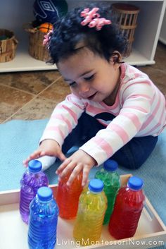Excited to explore the water-bead sensory bottles