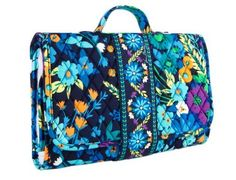 Baby changing pad clutch, by Vera Bradley. Easy to carry and functional. A must have when traveling,