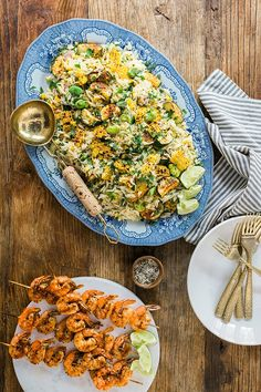 A recipe for roasted zucchini, corn, and fava bean orzo salad with spicy shrimp skewers...a easy, healthy under 30 minute dinner!
