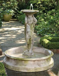 """A charming focal point for the garden, our two-piece, recirculating fountain is crafted of a mixture of sand and stone backed by fiberglass. It comes with a 250 GPH pump; just add water with a hose. Made in the USA, the fountain and pool will endure variable weather. Pool: 54""""DIA. X 13""""H."""