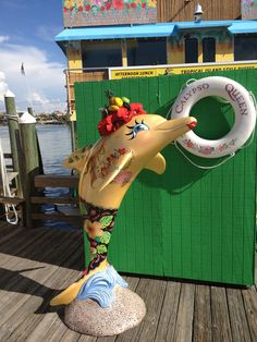 """""""Calypso Gal"""" dolphin, done by artist Lisa Holt, is in front of the Calypso Queen at #Clearwater Beach marina.  Isn't she pretty?"""