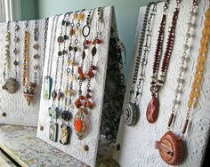Necklace Displays - could either use wallpaper or cloth - would pad back for pinning necklaces to boards