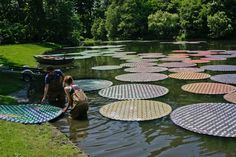 Set along the landscape of Longwood Gardens in Kennett Square, Pennsylvania, Monro recently completed a solo show in which he covered the 23 acres of the Gardens with a handful of complicated light designs. Using CDs as the basis for this particular piece, Monro upcycled more than 65,000 discs to form these contemporary Waterlilies in Bloom.