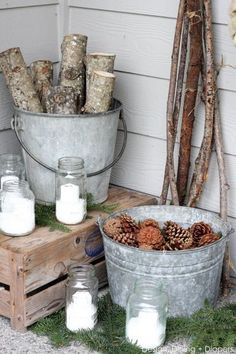 Rustic Winter White Porch- branches, pinecones & snow-filled mason jar candles.