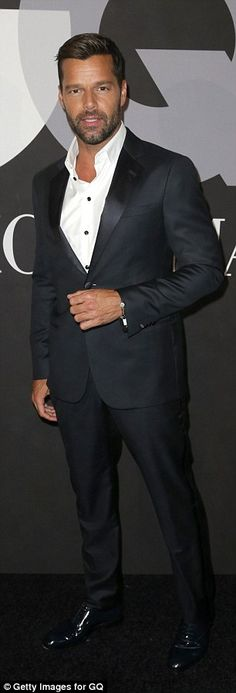 Suited and booted: Ricky Martin appeared to be flying solo on the night