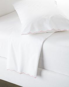 Our cloud-white bedding is one of those tried-and-true basics that goes with anything. Scallop detailing brings a sweet vintage vibe.