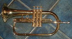 The flugelhorn (/ˈfluːɡəl.hɔrn/—also spelled fluegelhorn, flugel horn, or flügelhorn—from German, wing horn, German pronunciation: [ˈflyːɡl̩hɔʁn]) is a brass instrument that resembles a trumpet but has a wider, conical bore.