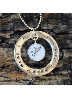 Order Swim Bike Run necklace and triathlon gifts. The triathlon charm showcases your choice of a word or image. Monogram Necklace, Personalized Necklace, Personalized Gifts, Mommy Necklace, Washer Necklace, Running Jewelry, Gifts For Runners, Bike Run, Hand Stamped Jewelry