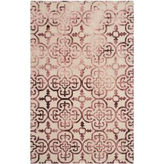 Anchor your living room seating group or lend a pop of pattern to the master suite with this hand-tufted wool rug, showcasing a quatrefoil trellis design.