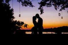 Sunset silhouette of bride + groom // Romantic Pink, Peach + Sea Green Wedding at Oak Point Plantation on the Stono in Charleston SC // Dana Cubbage Weddings // Charleston SC + Destination Wedding Photographer