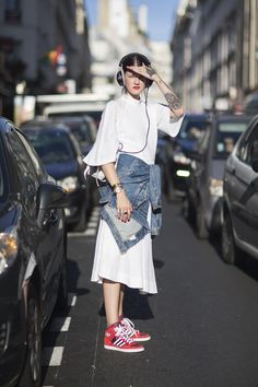 """Paris Fashion Week SS2015 Marianne Theodorsen, blogger """"I'm wearing Beyer Dynamic earphones with an Epilogue dress, Adidas shoes, a Levi's jacket and a Proenza Schouler bag."""""""