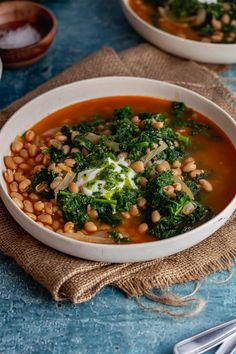 This comforting kale and white bean soup is spiced with harissa and topped with a quick lemon and parsley oil for an extra hit of herby flavour. Serve with plenty of crusty bread. #thecookreport #whitebeansoup #souprecipe #veganrecipe White Bean Soup, White Beans, Soup Recipes, Vegan Recipes, One Pot Meals, Kale, Spices, Great Northern Beans, Collard Greens